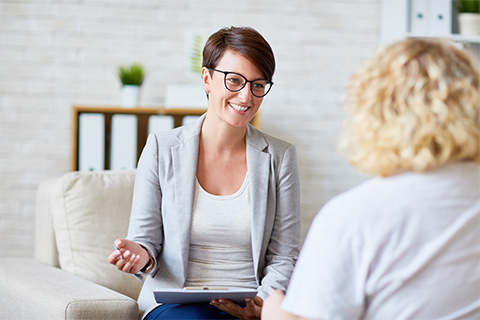 Image of a woman speaking with a counselor