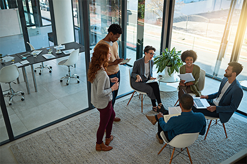 Image of a small group of employee in a meeting